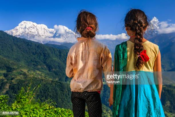 Nepali little girls looking at Annapurna South