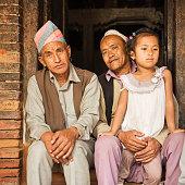 Nepali men sitting near Durbar Square, Bhaktapur, Nepal'
