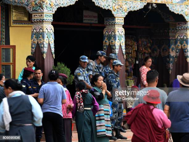 Nepali police guard the premises of Buddhist site Boudhanath Stupa to prevent mass gatherings of Tibetansinexile amid events to mark the Dalai Lama's...
