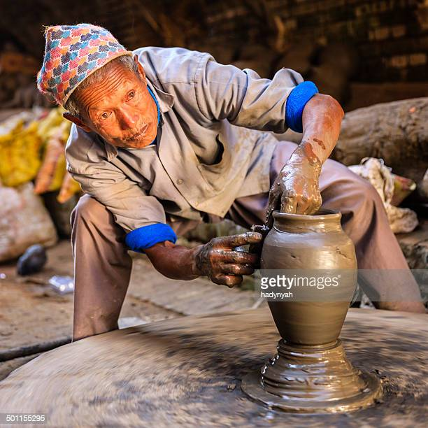 Nepali potter working on the pottery square in Bhaktapur