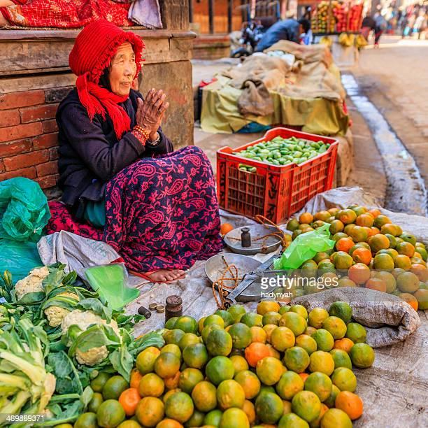 Nepali street seller selling vegetables in Bhaktapur, Nepal