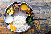 Nepali Thali meal set with mutton curry from top angle