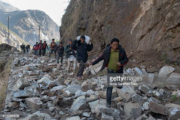 Nepali victims of the earthquake flee from their homes on Arakani road May 1 2015 in Sindhupalchok Nepal The road from Bahrabise to Lipim the last...