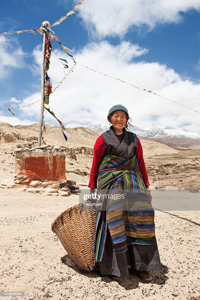 Nepali woman carrying basket in Mustang Region, Nepal