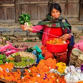 Nepali woman selling flowers in Patan