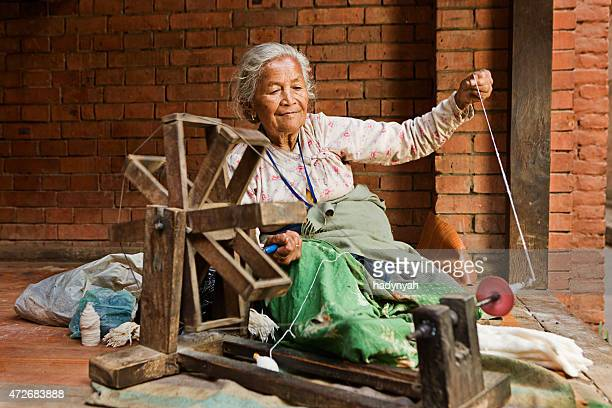 Nepali woman spinning the wool. Bhaktapur