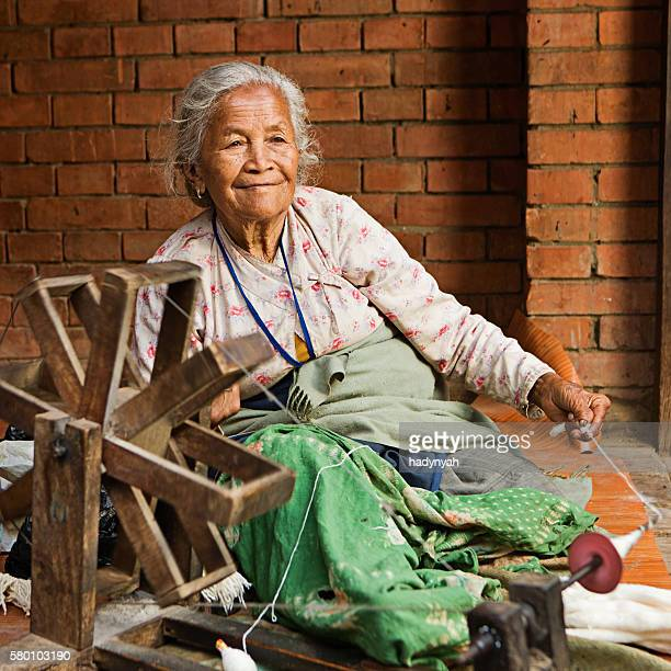 Nepali woman spinning the wool in Bhaktapur