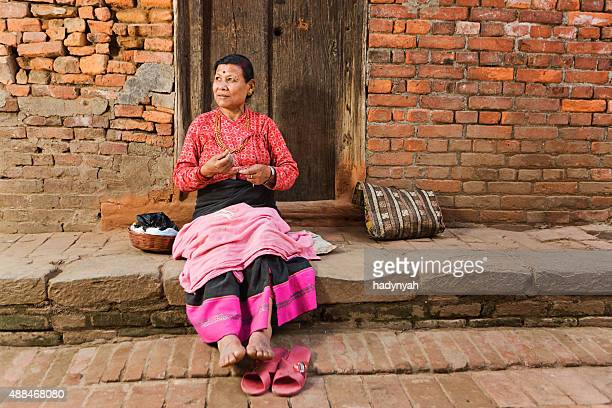 Nepali woman spinning the wool