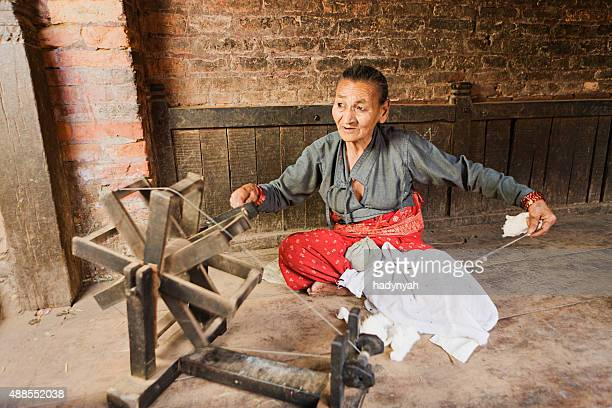 Nepali woman spinning the wool
