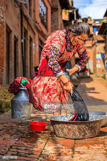 Nepali woman washing clothes on the street in Bhaktapur
