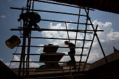 Nepali workers begin repairs on the roof of the Patan Museum in Patan Nepal on May 4 2015 On April 25 Nepal suffered a magnitude 78 earthquake...