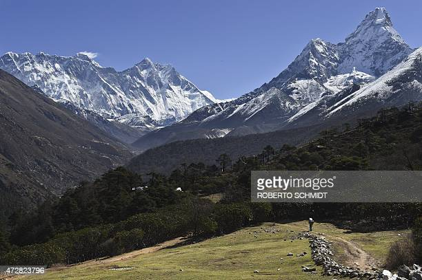 NepalquakeEveresttourismmountaineeringFOCUS by Ammu Kannampilly This photograph taken on April 20 2015 shows a view of a Nepalese porter carrying a...