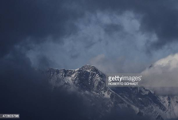 NepalquakeEveresttourismmountaineeringFOCUS by Ammu Kannampilly This photograph taken on April 19 2015 shows a view of Mount Everest towering over...