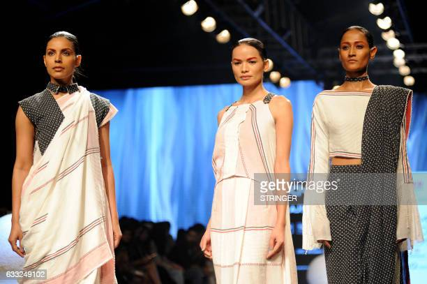 Nepal's first transgender model Anjali Lama showcases a creation by designer Gen Next at Lakmé Fashion Week Summer Resort 2017 in the Indian city of...