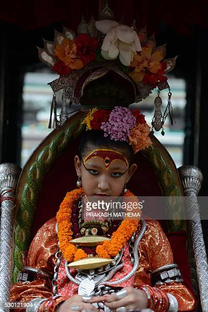 Nepal's Kumari considered a living goddess attends festivities on the first day of the Rato Machindranath Chariot Festival in Lalitpur near Kathmandu...