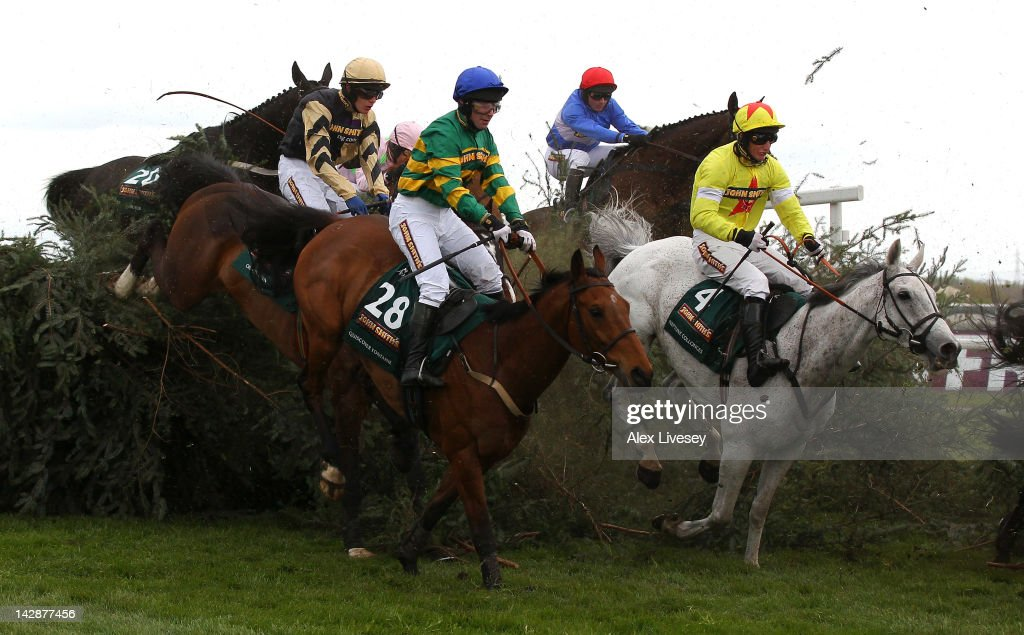 Neptune Collonges (4) ridden by Daryl Jacob clears The Chair fence alongside Quiscover Fontaine ridden by D.J Casey on their way to victory in The John Smith's Grand National Steeple Chase held at Aintree Racecourse on April 14, 2012 in Liverpool, England.