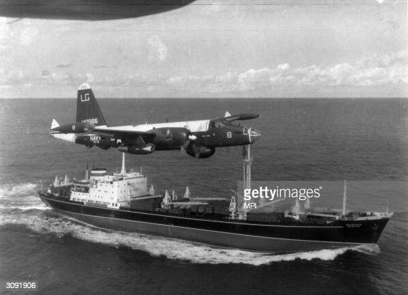 Neptune US patrol plane flying over a Soviet freighter during the Cuban missile crisis