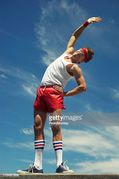 Nerd Athlete Stands Stretching Against Blue Sky