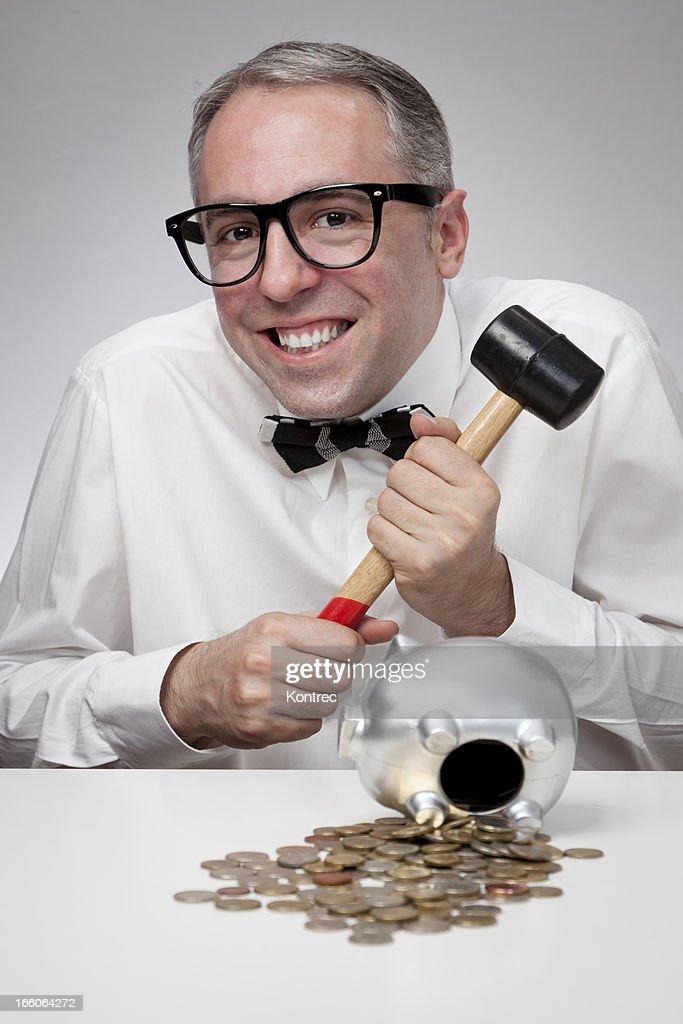 Nerd businessman saving money in a piggy bank