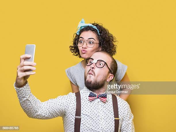 Nerd couple taking selfies