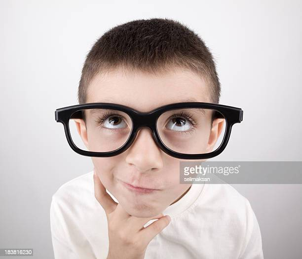 Nerd Looking Little Boy Wearing Large Black Glasses And Thinking