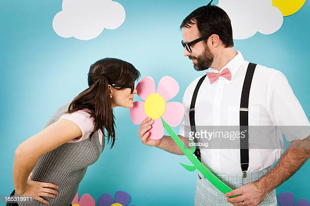 Nerd homme donnant une fleur à la petite fille Pourtant, fantaisistes du monde