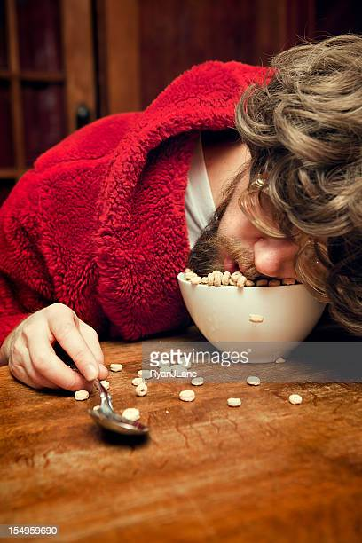 Nerd Man with Bathrobe Sleeping in Cereal