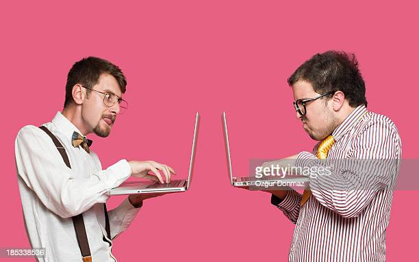 Nerd students using laptop