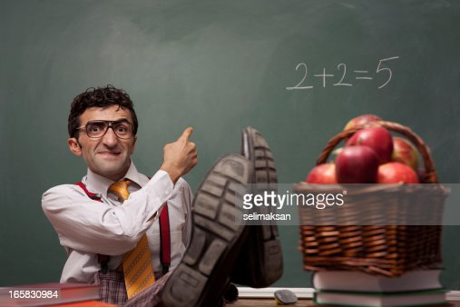 Nerd teacher in classroom with basket of apples