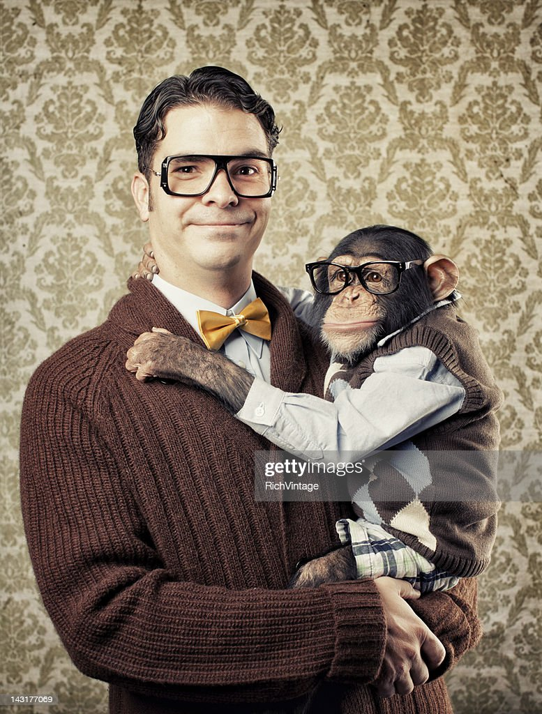 Nerd with a Chimp : Stock Photo