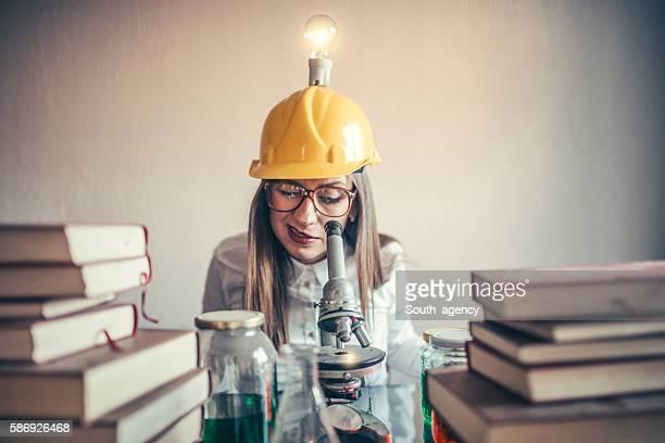 Nerd woman chemist in lab