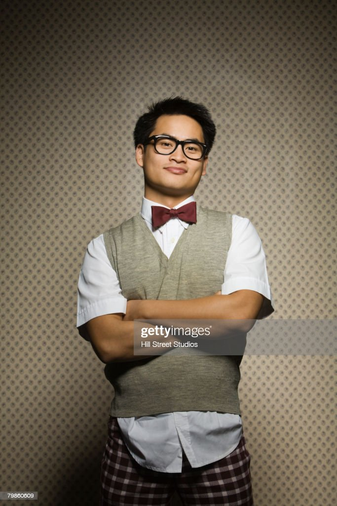 Nerdy Asian man with arms crossed
