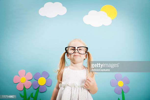 Nerdy, Blond-Haired Little Girl with Cheesy Smile