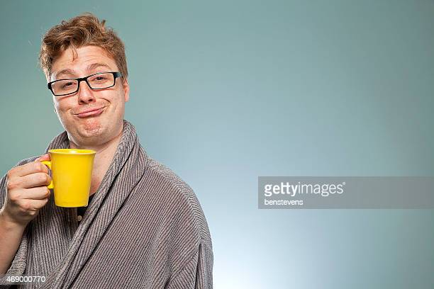 Nerdy guy drinking coffee