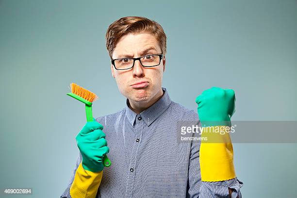 Nerdy guy getting ready to clean