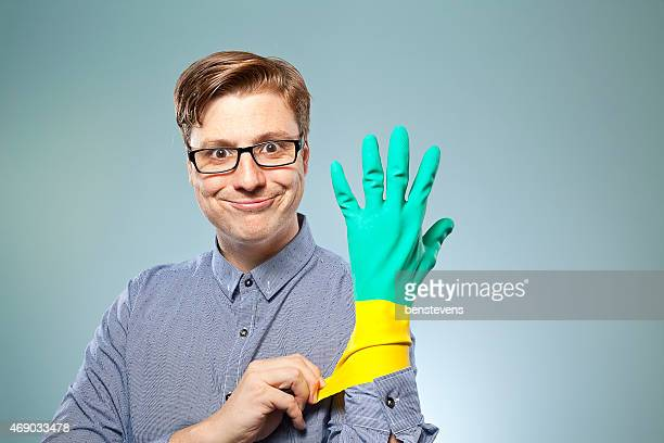 Nerdy guy putting rubber gloves on