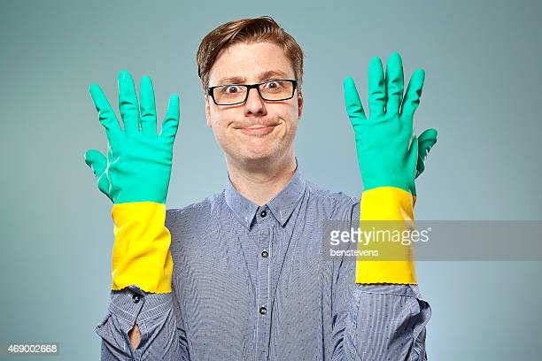 Nerdy guy with rubber cleaning gloves