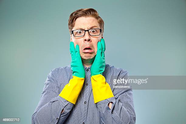 Nerdy guy with rubber gloves on