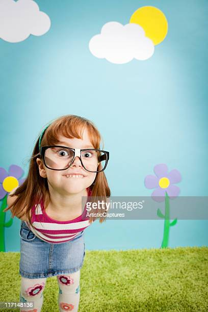 Nerdy Little Girl Smiling in Whimsical, Outdoor World