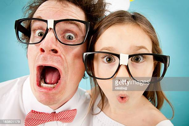 Nerdy Man and Young Girl Gasping with Look of Surprise