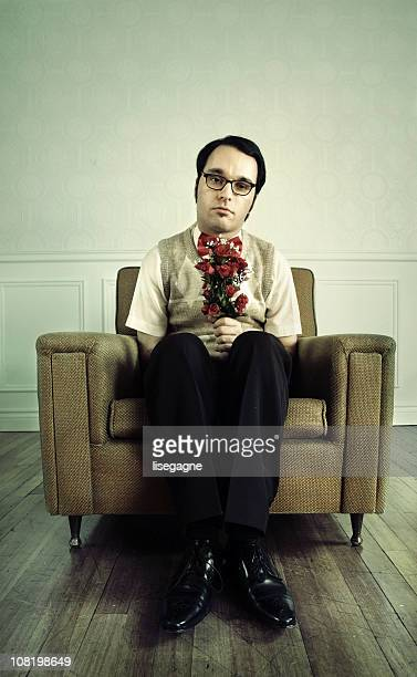 Nerdy Man Sitting in Chair with Flowers