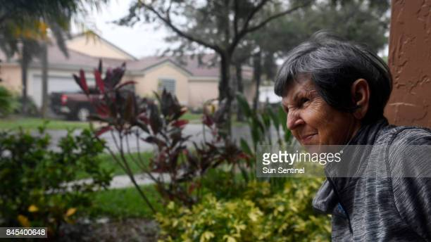 Nereida Lezcano says she has never seen anything like this as she looks outside as Hurricane Irma's bands cause downed trees and damage in the area...