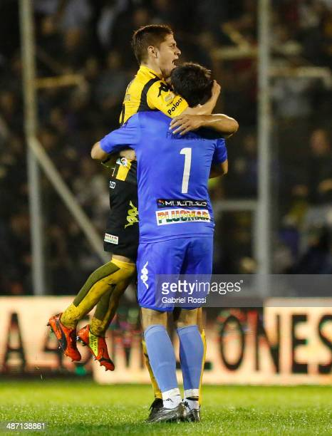 Nereo Champagne and Leonardo Gil of Olimpo celebrate their team's goal during a match between Olimpo and River Plate as part of 16th round of Torneo...