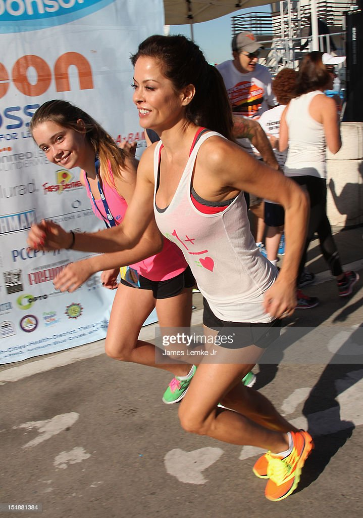 Neriah and <a gi-track='captionPersonalityLinkClicked' href=/galleries/search?phrase=Brooke+Burke&family=editorial&specificpeople=203216 ng-click='$event.stopPropagation()'>Brooke Burke</a>-Charvet attend the 4th Annual SKECHERS Pier to Pier Friendship Walk on October 28, 2012 in Manhattan Beach, California.