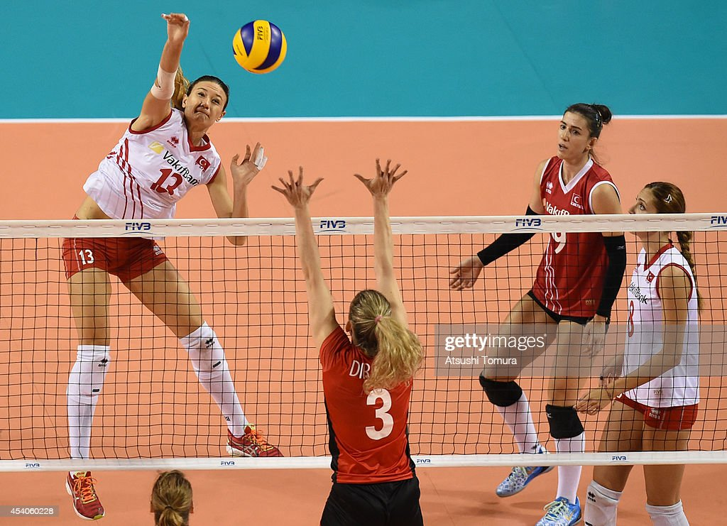 Neriman Ozsoy of Turkey spikes the ball during the FIVB World Grand Prix Final group one match between Turkey and Belgium on August 24, 2014 in Tokyo, Japan.