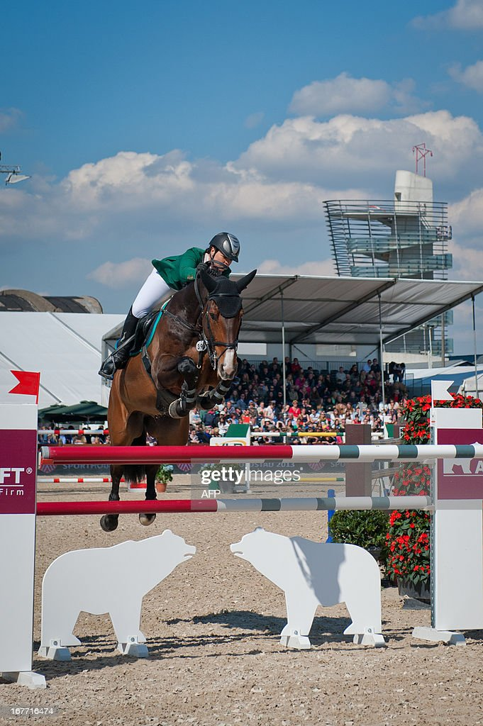Neriske Prinsloo of South Africa rides her horse Bill Clinton at the Grand Prix of the sixth edition of Antwerp jumping, on April 28, 2013.