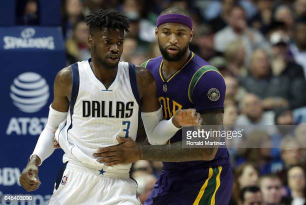 Nerlens Noel and DeMarcus Cousins of the New Orleans Pelicans during play in the first quarter at American Airlines Center on February 25 2017 in...