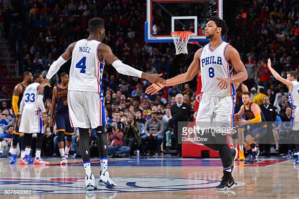 Nerlens Noel and Jahlil Okafor of the Philadelphia 76ers shake hands during the game against the Cleveland Cavaliers at the Wells Fargo Center on...