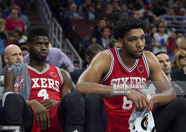 Nerlens Noel and Jahlil Okafor of the Philadelphia 76ers sit on the bench in the final minutes of the game against the Cleveland Cavaliers on...