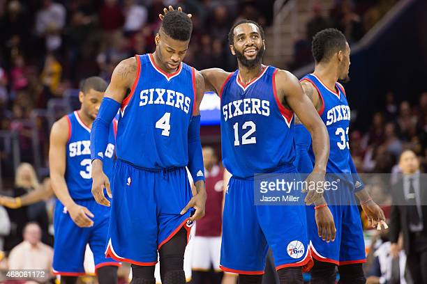 Nerlens Noel and Luc Richard Mbah a Moute of the Philadelphia 76ers react after being defeated by the Cleveland Cavaliers at Quicken Loans Arena on...